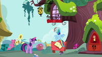 Rainbow sits on the library signboard S4E21