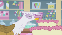 Gilda blowing out cake candles S1E05