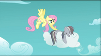 Fluttershy gently prods Rainbow Dash S2E02
