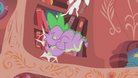Spike slams into the bookshelf S1E07