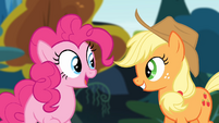 Pinkie Pie and Applejack smiling while looking at each other S4E09