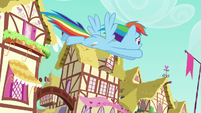 Rainbow Dash flying across Ponyville S6E9