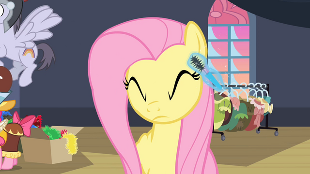 File:Fluttershy getting mascara S2E11.png