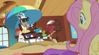 Discord lounging on a beach chair S6E17