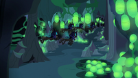Changelings fly past Discord's hiding spot S6E26