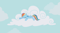 Rainbow Dash resting on a cloud S01E05