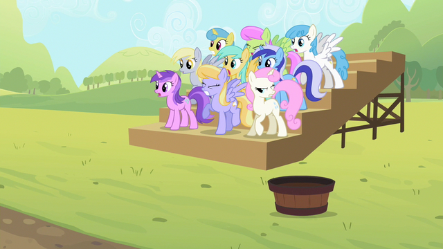 File:The ponies observe the competition S2E05.png
