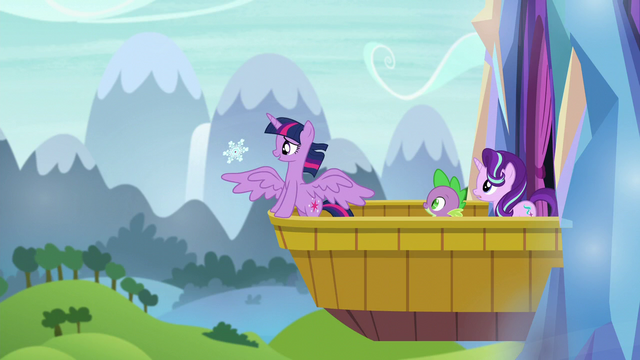 File:Twilight catches snowflake on her wing S6E1.png