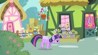 Twilight walking suspiciously with box S1E25