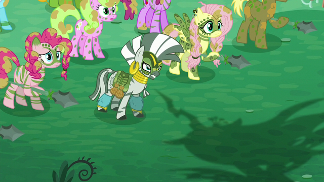 File:Zecora and ponies look at Chrysalis while her shadow appears S5E26.png
