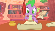 Spike writing a letter to the Princess S1E24