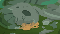 Applejack's hat stuck under the fallen statue S5E16