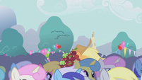 Applejack makes her way through the crowd S1E04
