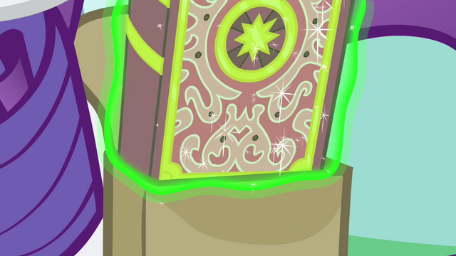 File:Book being levitated from the saddlebag S4E23.png