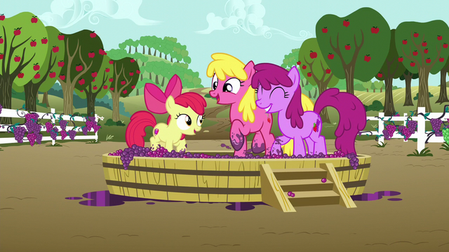 File:Apple Bloom and ponies stomping on a tub of grapes S6E4.png