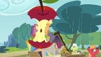 Two umbrellas taking the form of an apple core S4E09