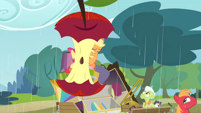File:Two umbrellas taking the form of an apple core S4E09.png