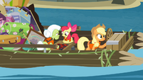 Apple Bloom and Granny Smith playing a game while Applejack controls the raft S4E09