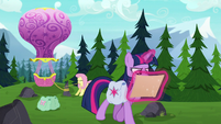 Twilight looks at map while Fluttershy ties up balloon S5E23