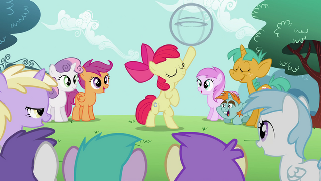 File:Apple Bloom has the hoop on her hoof S2E06.png