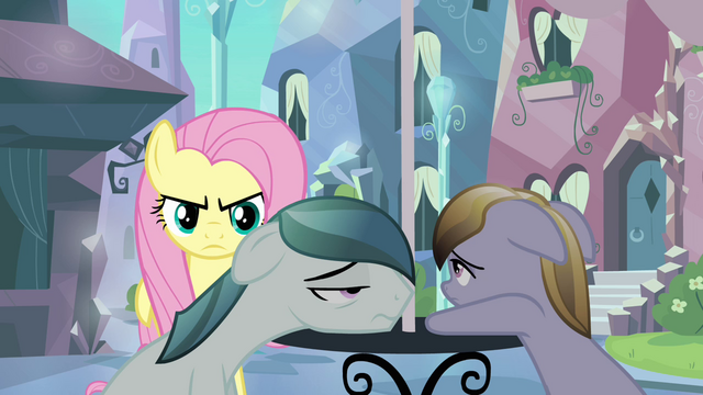 File:Fluttershy creeping behind locals S3E1.png