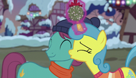 Lemon Hearts kissing a stallion's cheek S6E8