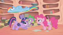 Rainbow Dash cruising over Twilight, Spike, and Pinkie S1E09