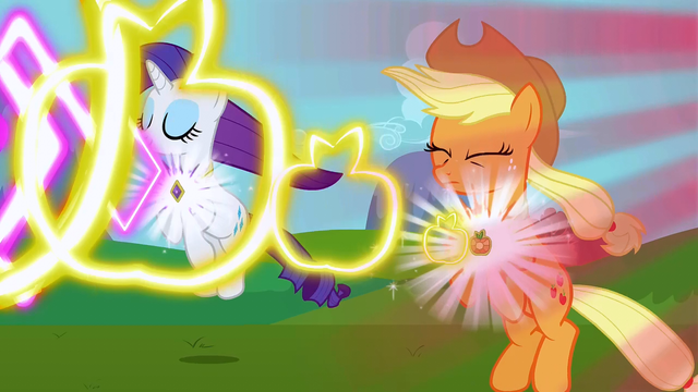 File:Rarity and Applejack's elements activating S3E10.png