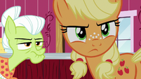 Applejack looking back toward the farm gate S6E23