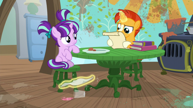 File:Sunburst cleans spill while reading spell scroll S6E1.png