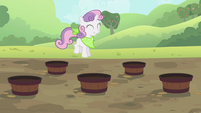 Sweetie Belle hopping through the buckets S2E05