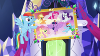 Rainbow Dash points at the Mane Six portrait S5E3