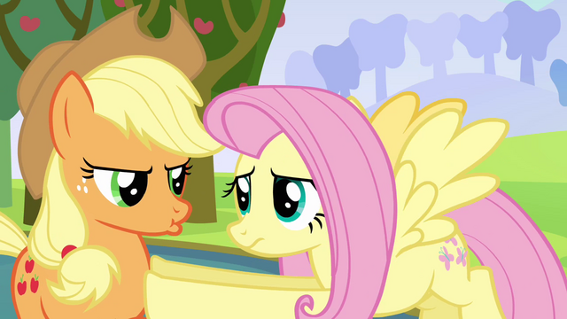 File:Fluttershy holds back pouting Applejack S03E10.png