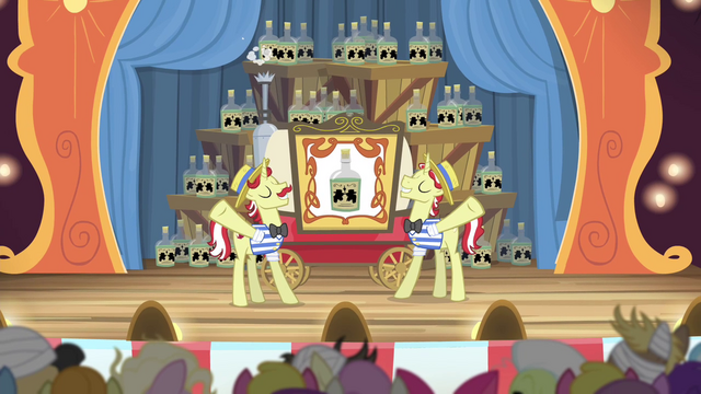File:Curtain opens to reveal many bottles of tonic S4E20.png