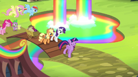 Main Six and Spike entering the Rainbow Falls Traders Exchange S4E22