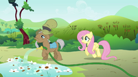 Mr. Greenhooves over watering Fluttershy's petunias S2E19