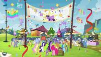 The ponies celebrating Twilight's arrival S4E22
