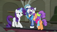 Rarity levitates Mr. Stripes's hoof off of her S6E9