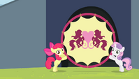 Apple Bloom and Sweetie Belle holding up the hoop S4E24