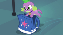 Spike ducks inside Twilight's bag EG