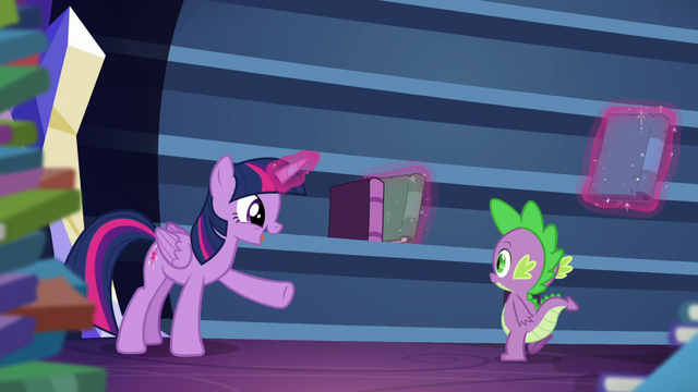 File:Twilight talking while levitating some books into bookshelf S5E22.png