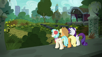 Rarity, AJ, and Coco outside the dilapidated park S5E16
