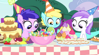 Foals looking at table of treats S4E23