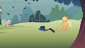 Applejack pulling down branches S1E08.png