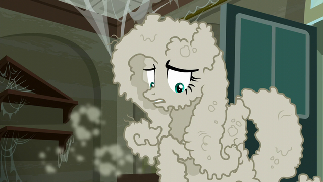 File:Fluttershy tries to shake off the dust on her S6E9.png