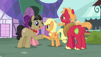 Young Applejack and Filthy Rich shaking hooves S6E23