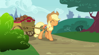 Applejack pulling a wagon full of apple brown bettys S4E10
