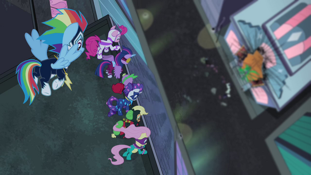 File:Power Ponies looking down at Mane-iac S4E06.png