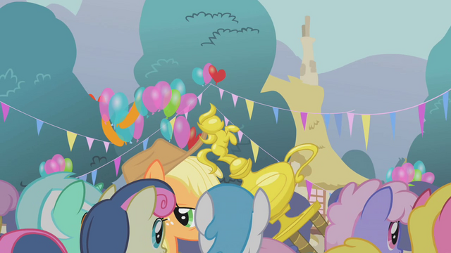 File:Applejack dragging her trophy S1E04.png