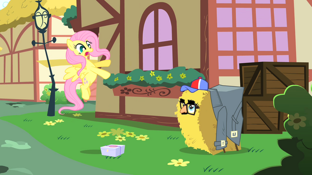 File:Fluttershy startled by Pinkie Pie in hay bale costume S1E25.png
